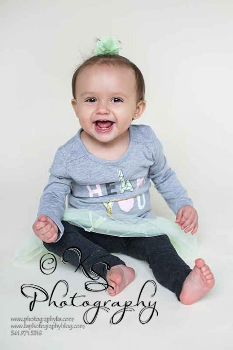 smiling one year old girl
