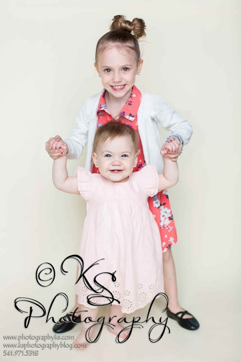baby and sister standing
