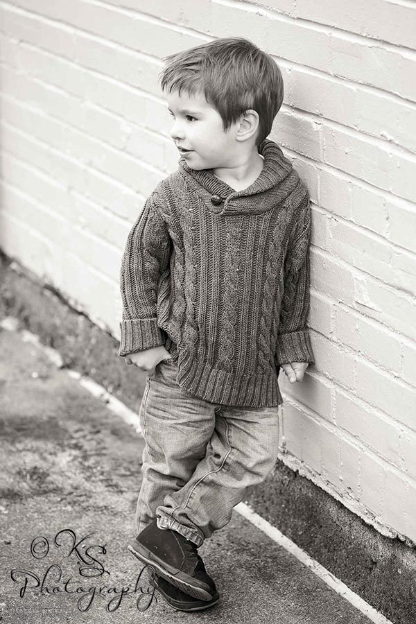 black and white toddler boy looking away