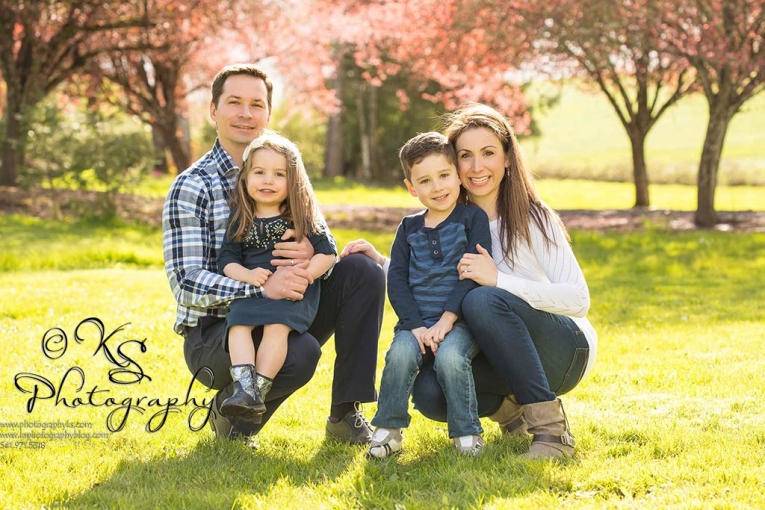 family of four in spring blossoms