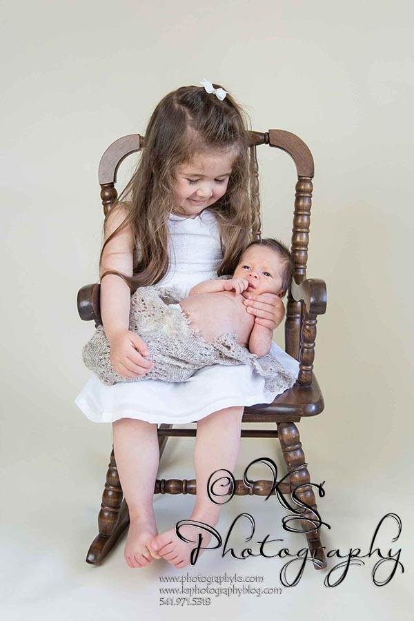 sister and brother in rocking chair